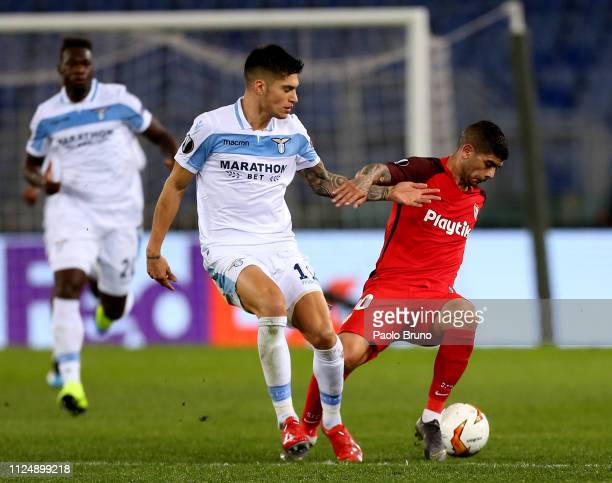 Ever Banega of Sevilla competes for the ball with Joaquin Correa of SS Lazio during the UEFA Europa League Round of 32 first leg match between SS...