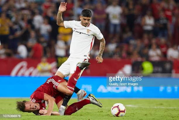 Ever Banega of Sevilla competes for the ball with Martin Nespor of Sigma Olomuc during the UEFA Europa League Qualifying PlayOff Second Leg match...