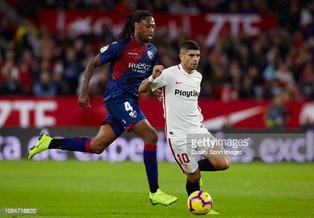 Ever Banega of Sevilla competes for the ball with Ruben Semedo of Huesca during the La Liga match between Sevilla FC and SD Huesca at Estadio Ramon...