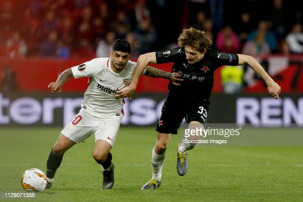 Ever Banega of Sevilla FC Alex Kral of SK Slavia Praha during the UEFA Europa League match between Sevilla v Slavia Prague at the Estadio Ramon...