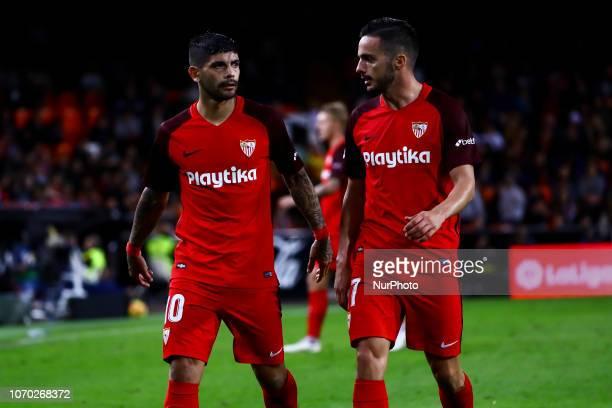 Ever Banega of Sevilla FC and Sarabia of Sevilla FC during spanish La Liga match between Valencia CF v Sevilla FC at Mestalla Stadium on December 8...