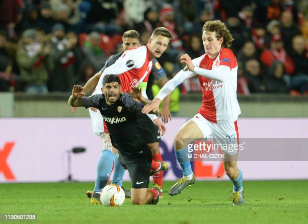 Ever Banega of Sevilla FC and Slavia Prague's Alex Kral vie for the ball during the UEFA Europa League last 16 second leg football match Salzburg v...