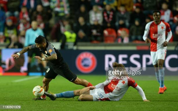 Ever Banega of Sevilla FC and Slavia Prague's Alex Kral vie for the ball during the UEFA Europa League last 16 second leg football match Slavia...