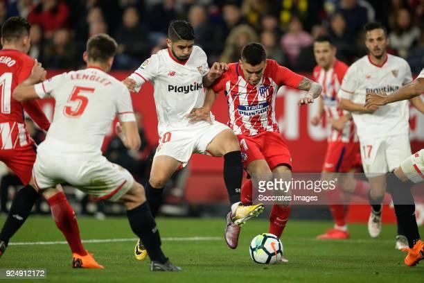 Ever Banega of Sevilla FC Angel Correa of Atletico Madrid during the La Liga Santander match between Sevilla v Atletico Madrid at the Estadio Ramon...