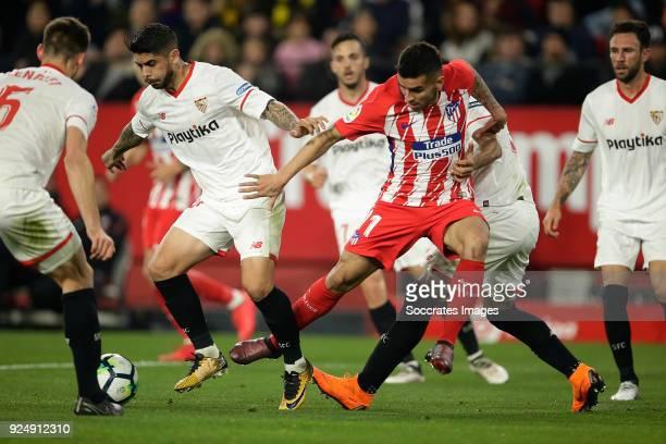 Ever Banega of Sevilla FC Angel Correa of Atletico Madrid Gabriel Mercado of Sevilla FC during the La Liga Santander match between Sevilla v Atletico...