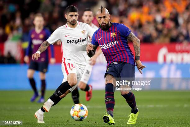 Ever Banega of Sevilla FC Arturo Vidal of FC Barcelona during the Spanish Copa del Rey match between Sevilla v FC Barcelona at the Estadio Ramon...