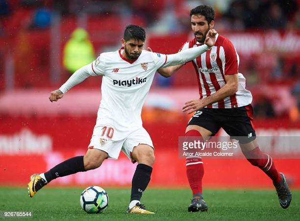 Ever Banega of Sevilla FC being followed by Raul Garcia of Athletic Club during the La Liga match between Sevilla and Athletic Club at Estadio Ramon...