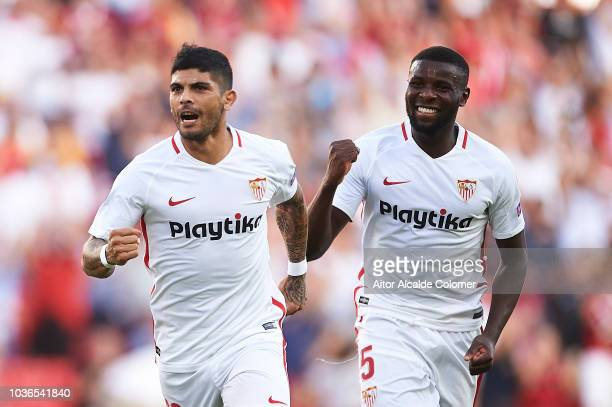 Ever Banega of Sevilla FC celebrates after scoring Ibrahim Amadou of Sevilla FC during the UEFA Europa League Group J match between Sevilla and Royal...