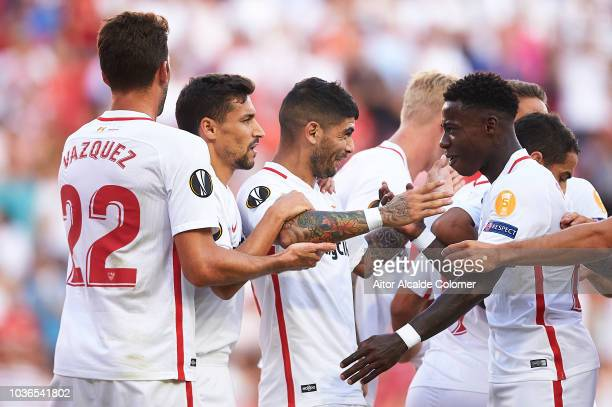 Ever Banega of Sevilla FC celebrates after scoring Quincy Promes of Sevilla FC during the UEFA Europa League Group J match between Sevilla and Royal...