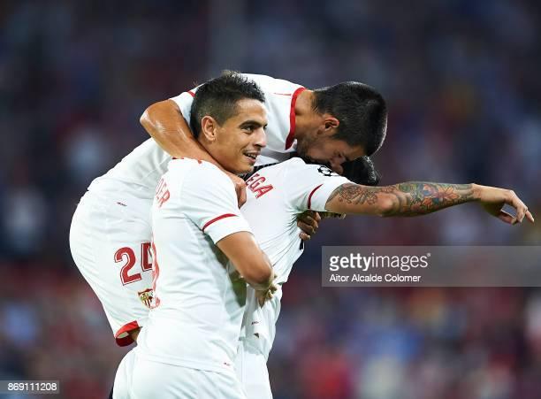 Ever Banega of Sevilla FC celebrates after scoring the second goal for Sevilla FC with Manuel Agudo 'Nolito' of Sevilla FC and Wissam Ben Yedder of...