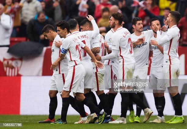 Ever Banega of Sevilla FC celebrates scoring his team's opening goal with team mates during the La Liga match between Sevilla FC and Girona FC at...
