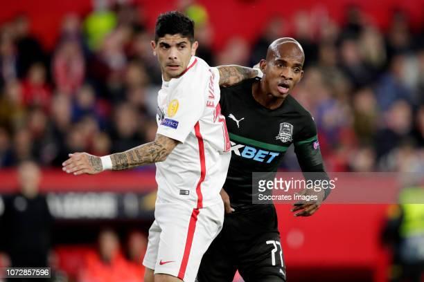 Ever Banega of Sevilla FC Charles Kabore of Krasnodar during the UEFA Europa League match between Sevilla v Krasnodar at the Estadio Ramon Sanchez...