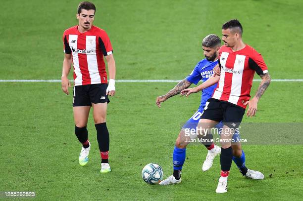 Ever Banega of Sevilla FC competes for the ball with Dani Garcia of Athletic Club during the Liga match between Athletic Club and Sevilla FC at San...