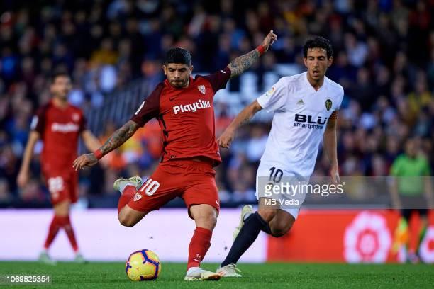 Ever Banega of Sevilla FC competes for the ball with Dani Parejo of Valencia CF during the La Liga match between Valencia CF and Sevilla FC at...