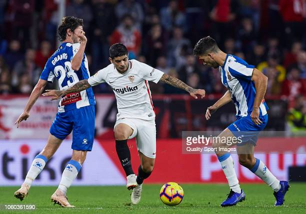Ever Banega of Sevilla FC competes for the ball with Esteban Granero and Marc Roca of Espanyol during the La Liga match between Sevilla FC and RCD...