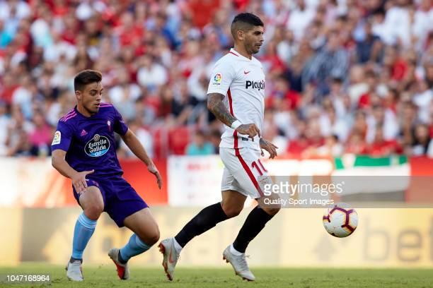 Ever Banega of Sevilla FC competes for the ball with Francisco Beltran of RC Celta de Vigo during the La Liga match between Sevilla FC and RC Celta...