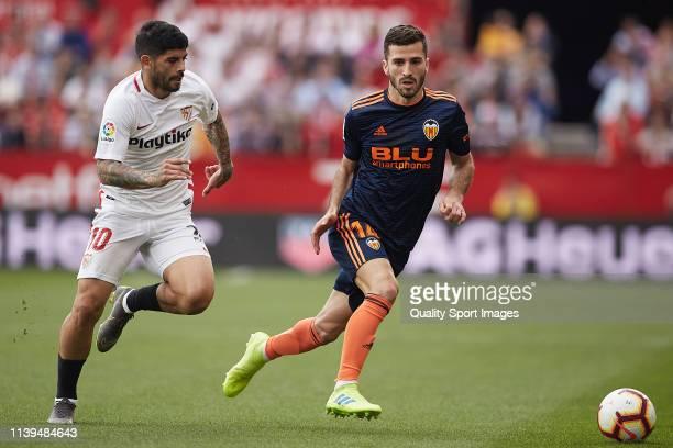 Ever Banega of Sevilla FC competes for the ball with Jose Luis Gaya of Valencia CF during the La Liga match between Sevilla FC and Valencia CF at...