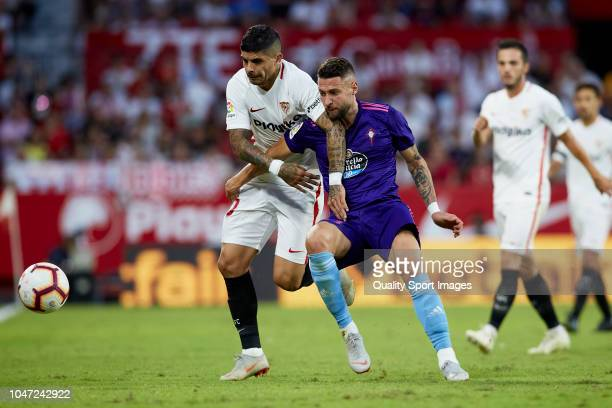 Ever Banega of Sevilla FC competes for the ball with Junca of RC Celta de Vigo during the La Liga match between Sevilla FC and RC Celta de Vigo at...