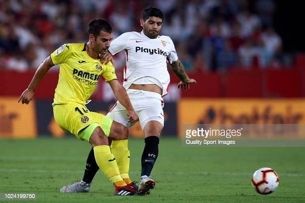 Ever Banega of Sevilla FC competes for the ball with Manuel Trigueros of Villarreal CF during the La Liga match between Sevilla FC and Villarreal CF...