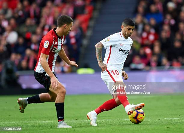 Ever Banega of Sevilla FC competes for the ball with Oscar De Marcos of Athletic Club during the La Liga match between Athletic Club and Sevilla FC...