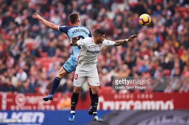 Ever Banega of Sevilla FC competes for the ball with Pere Pons of Girona FC during the La Liga match between Sevilla FC and Girona FC at Estadio...