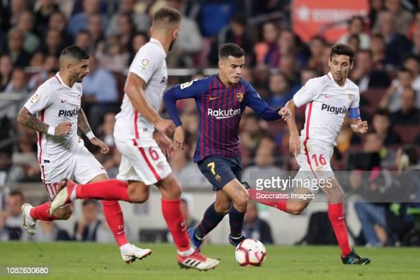 Ever Banega of Sevilla FC Daniel Carrico of Sevilla FC Philippe Coutinho of FC Barcelona during the La Liga Santander match between FC Barcelona v...