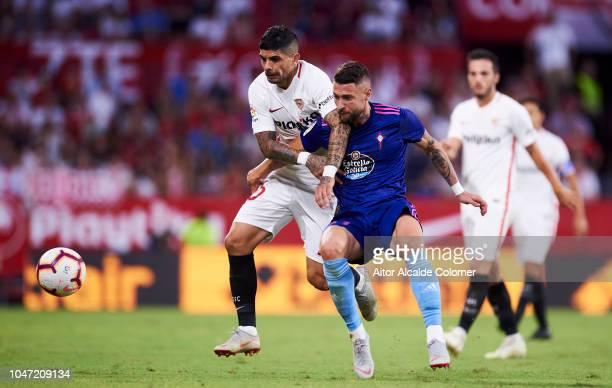 Ever Banega of Sevilla FC duels for the ball with David Junca of RC Celta de Vigo during the La Liga match between Sevilla FC and RC Celta de Vigo at...