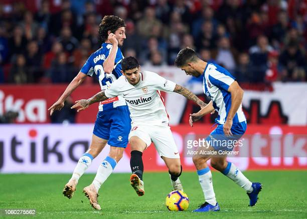 Ever Banega of Sevilla FC duels for the ball with Didac Vila of RCD Espanyol during the La Liga match between Sevilla FC and RCD Espanyol at Estadio...