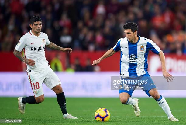 Ever Banega of Sevilla FC duels for the ball with Javier Lopez of RCD Espanyol during the La Liga match between Sevilla FC and RCD Espanyol at...