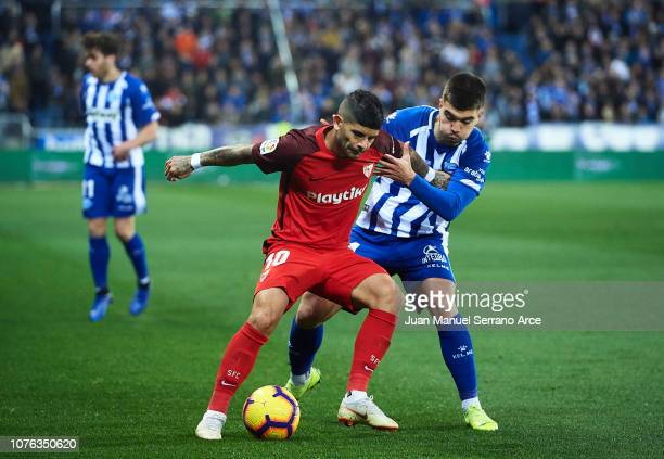 Ever Banega of Sevilla FC duels for the ball with Martin Aguirregabiria of Deportivo Alaves during the La Liga match between Deportivo Alaves and...