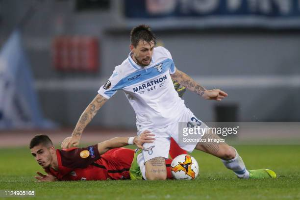 Ever Banega of Sevilla FC Francesco Acerbi of Lazio Roma during the UEFA Europa League match between Lazio v Sevilla at the Stadio Olimpico Rome on...