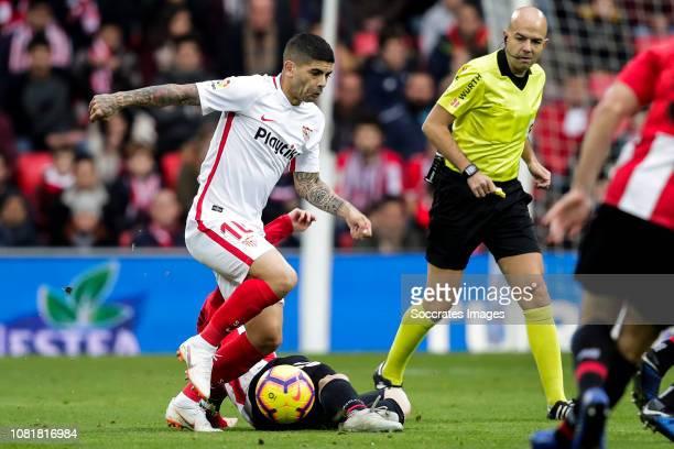 Ever Banega of Sevilla FC Iker Muniain of Athletic Bilbao during the La Liga Santander match between Athletic de Bilbao v Sevilla at the Estadio San...