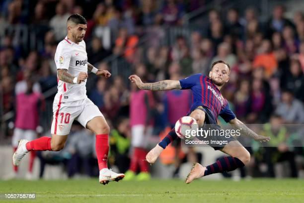 Ever Banega of Sevilla FC Ivan Rakitic of FC Barcelona during the La Liga Santander match between FC Barcelona v Sevilla at the Camp Nou on October...