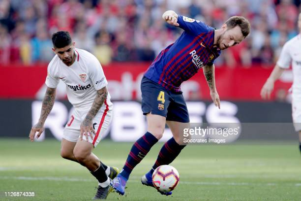 Ever Banega of Sevilla FC Ivan Rakitic of FC Barcelona during the La Liga Santander match between Sevilla v FC Barcelona at the Estadio Ramon Sanchez...