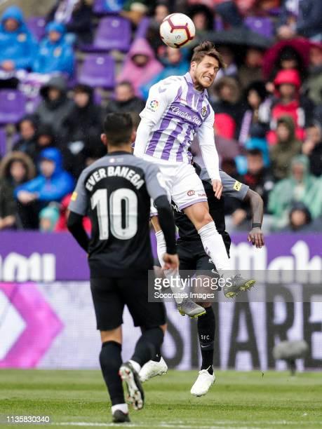 Ever Banega of Sevilla FC Keko Gontan of Real Valladolid during the La Liga Santander match between Real Valladolid v Sevilla at the Estadio Nuevo...