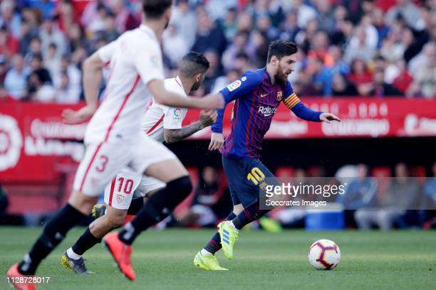 Ever Banega of Sevilla FC Lionel Messi of FC Barcelona during the La Liga Santander match between Sevilla v FC Barcelona at the Estadio Ramon Sanchez...