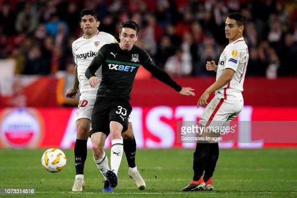 Ever Banega of Sevilla FC Mauricio Pereyra of KrasnodarWissam Ben Yedder of Sevilla FC during the UEFA Europa League match between Sevilla v...