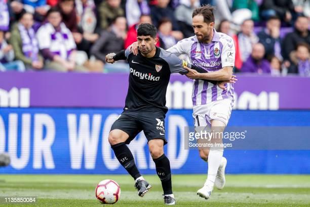 Ever Banega of Sevilla FC Michel of Real Valladolid during the La Liga Santander match between Real Valladolid v Sevilla at the Estadio Nuevo José...