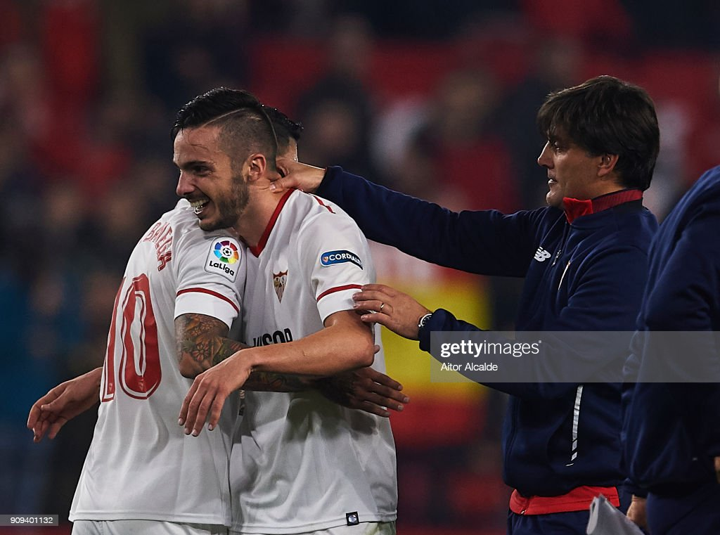 Ever Banega of Sevilla FC (L) Pablo Sarabia of Sevilla FC (C) celebrates after wining the match against Atletico de Madrid with his coach Vinzencio Montella of Sevilla FC (R) during the Copa del Rey, Quarter Final, second Leg match between Sevilla FC and Atletico de Madrid at Estadio Ramon Sanchez Pizjuan on January 23, 2018 in Seville, Spain.