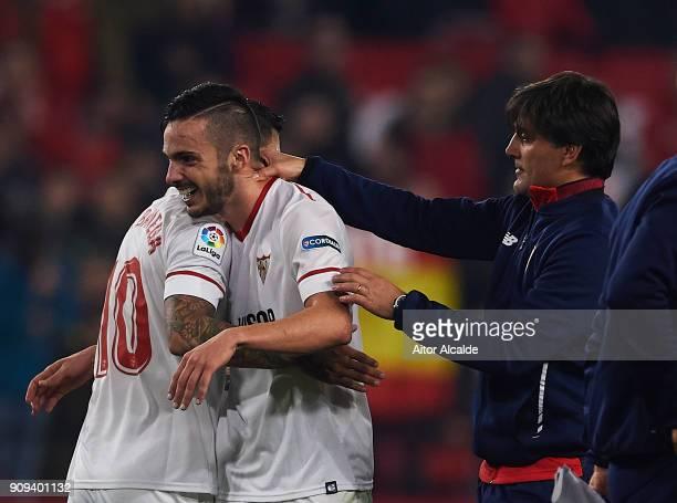 Ever Banega of Sevilla FC Pablo Sarabia of Sevilla FC celebrates after wining the match against Atletico de Madrid with his coach Vinzencio Montella...