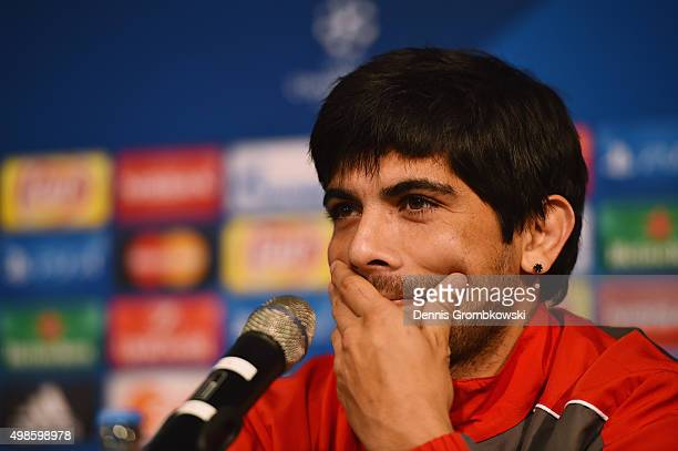 Ever Banega of Sevilla FC reacts during a press conference ahead of their UEFA Champions League Group D match against Borussia Moenchengladbach at...