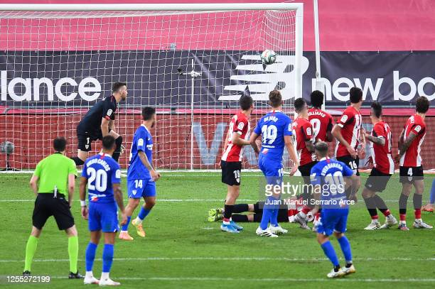 Ever Banega of Sevilla FC scores his team's first goal during the Liga match between Athletic Club and Sevilla FC at San Mames Stadium on July 09...
