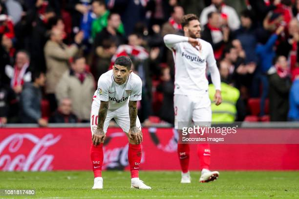Ever Banega of Sevilla FC Sergi Gomez of Sevilla FC during the La Liga Santander match between Athletic de Bilbao v Sevilla at the Estadio San Mames...