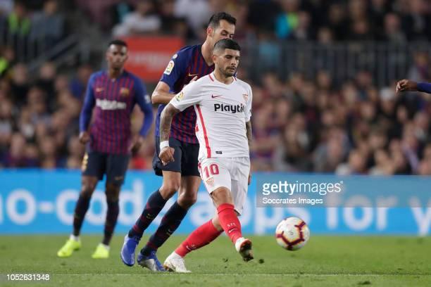 Ever Banega of Sevilla FC Sergio Busquets of FC Barcelona during the La Liga Santander match between FC Barcelona v Sevilla at the Camp Nou on...