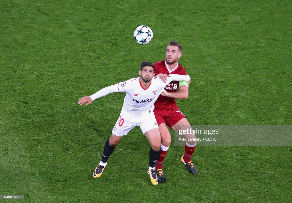 Ever Banega of Sevilla FC shields the ball from Jordan Henderson of Liverpool FC during the UEFA Champions League group E match between Liverpool FC and Sevilla FC at Anfield on September 13, 2017 in Liverpool, United Kingdom.