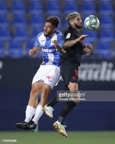 Ever Banega of Sevilla FC wins the header over Miguel Angel Guerrero of Deportivo Leganes during the Liga match between CD Leganes and Sevilla FC at...