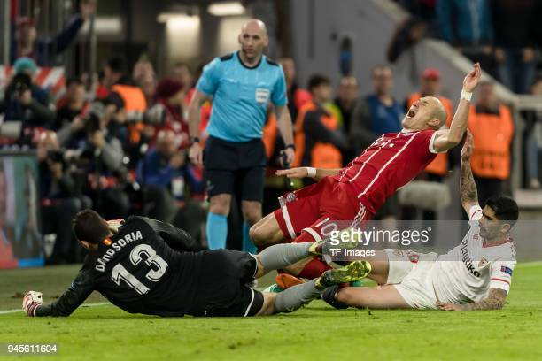 Ever Banega of Sevilla goalkeeper David Soria of Sevilla and Arjen Robben of Muenchen battle for the ball during the UEFA Champions League quarter...