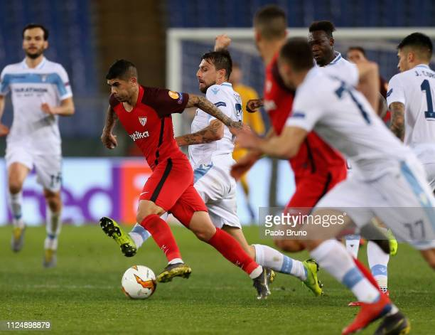Ever Banega of Sevilla in action against SS Lazio players during the UEFA Europa League Round of 32 first leg match between SS Lazio and Sevilla at...