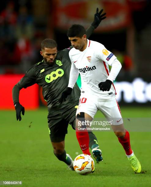 Ever Banega of Sevilla is challenged by Mehdi CarcelaGonzalez of Standard Liege during the UEFA Europa League Group J match between Royal Standard de...