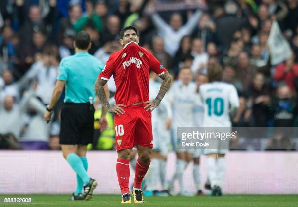 Ever Banega of Sevilla reacts after Real Madrid scored their 3rd goal during the La Liga match between Real Madrid and Sevilla at Estadio Santiago...